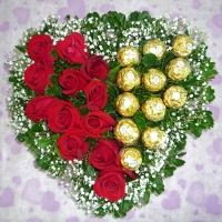Heart Shape Arrangement of roses 18 roses and 18 ferrero..